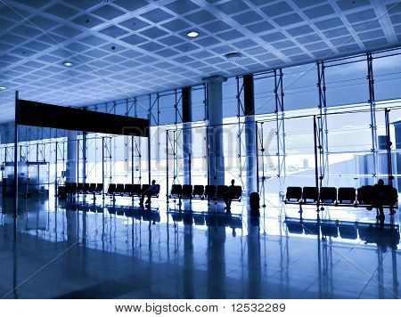 contemporary blue glass hallway inside business office center