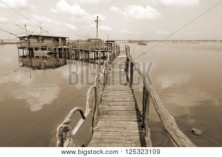 ancient fishing houses in the lagoon of Comacchio Italy