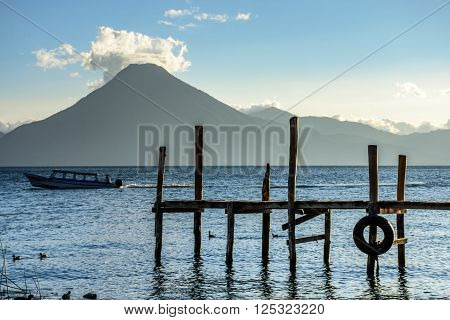 Evening light on Lake Atitlan with San Pedro volcano behind in Guatemalan highlands