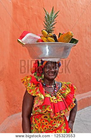 CARTAGENA COLOMBIA - FEB 04 : Palenquera woman sell fruts in Cartagena Colombia on Februery 04 2016. Palenqueras are a unique African descendat ethnic group found in the north region of South America