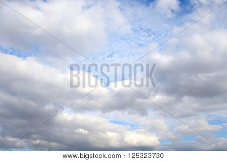 Sky with cumulus clouds may be used as background.