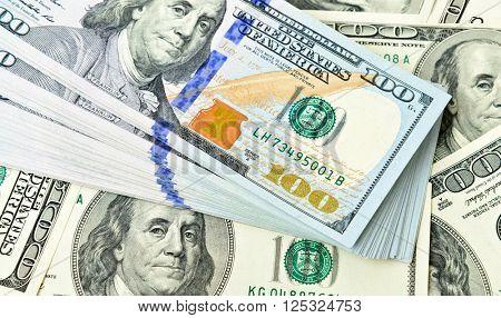 Stack of one hundred dollar bills close-up