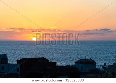 Vueltas on La Gomera. Sunset in the Atlantic ocean. The island La Gomera offers a fantastic nature and every day a very special afterglow at sundown. Gomera celebrate the sunset every day