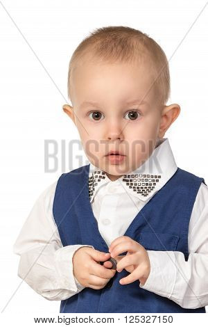 Close-up portrait of a little boy with protruding ears in the blue formal suit isolated on white background
