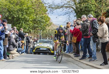 Conflans-Sainte-Honorine, France-March 6, 2016: The French cyclist Lilian Calmejane of Direct Energie Team riding during the prologue stage of Paris-Nice 2016.