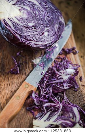 Red Cabbage Sliced On Farmhouse Table.
