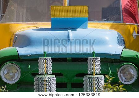 Close-up of painted car bumper in sunlight