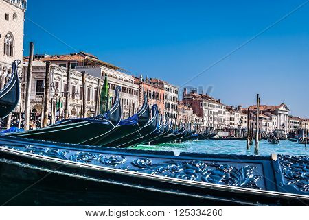 Gondolas are one of main attraction in lovely Venice. Road with gondola is unique experience and great touristic attraction in Venice, Italy.