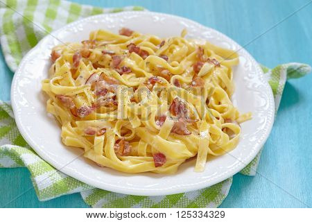 Homemade pasta carbonara with bacon and cheese