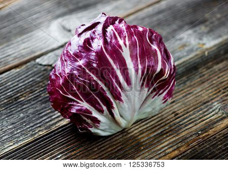 Fresh organic  Radicchio on vintage wooden background