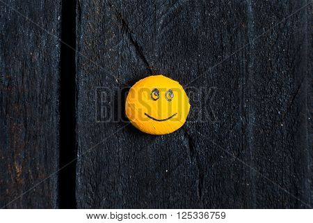 One yellow smile on table with happy face and look.