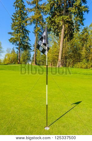 Golf flag at the beautiful golf course.