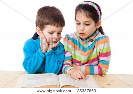 Two kids reading the book, isolated on white