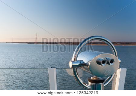 Telescope distant, electricity, pylons, expire, farsightedness, harbor, lake, look-out, magnification, ocean, power, sea, search, ship, shipping