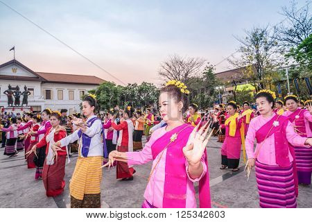 CHIANG MAI THAILAND - APRIL 11 : Unidentified dancer 720 people Nail dance (fon leb) celebrate 720 years Chiang Mai at Three Kings Monument on April 11 2016 in Chiang Mai Thailand.