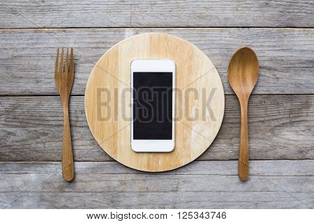 mobile phone served on wood plate. Concept and idea