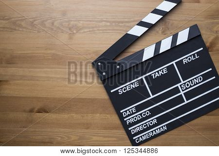 movie clapper on the old wood table