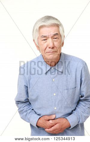 portrait of senior Japanese man suffers from stomachache ** Note: Soft Focus at 100%, best at smaller sizes