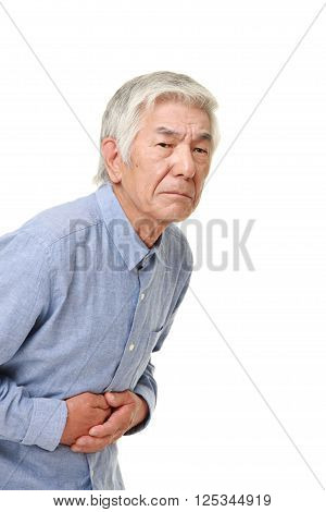 portrait of senior Japanese man suffers from stomachache