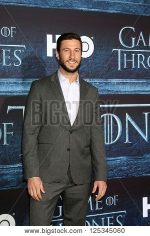 LOS ANGELES - APR 10:  Pablo Schreiber at the Game of Thrones Season 6 Premiere Screening at the TCL Chinese Theater IMAX on April 10, 2016 in Los Angeles, CA