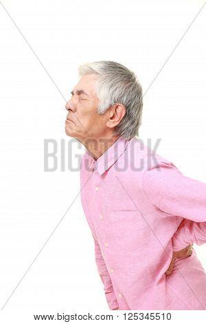 portrait of  senior Japanese man suffers from lumbago