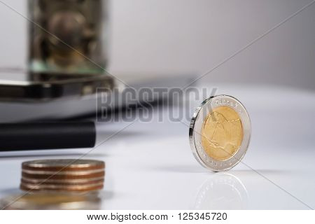 busines finance money and bookkeeping concept - coins on office table.