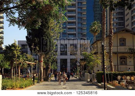 TEL AVIV, ISRAEL - APRIL 7, 2016 : People in Sarona Market area in Tel Aviv, Israel. Recently open Sarona Market became the most popular place in Tel Aviv.