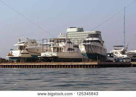 yacht at the pier in Vladivostok awaiting the opening of navigation