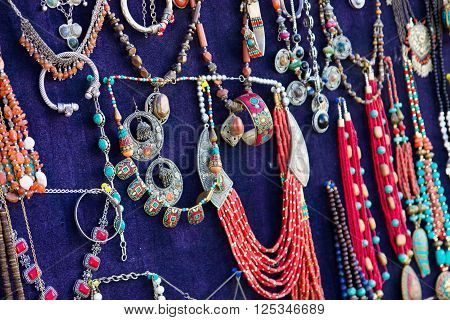 Colorful traditional uzbek beads and silver accessories in the bazaar