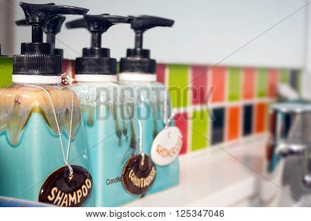Bathroom interior with body care luxury and hygiene concept - close up of liquid soap or body lotion