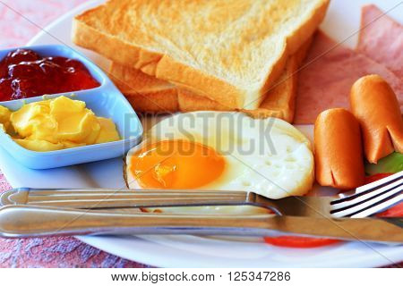 breakfast with fried eggs sausages cereal toasts and coffee