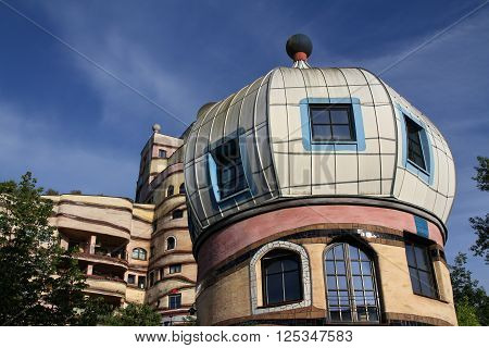 Darmstadt, Germany - May 19, 2015: View of the Forest Spiral, Darmstadt, Germany. The Waldspirale is a residential building complex in Darmstadt, Germany, built in the 1990s.