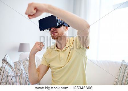 3d technology, virtual reality, gaming, entertainment and people concept - young man with virtual reality headset or 3d glasses playing combat game and fighting
