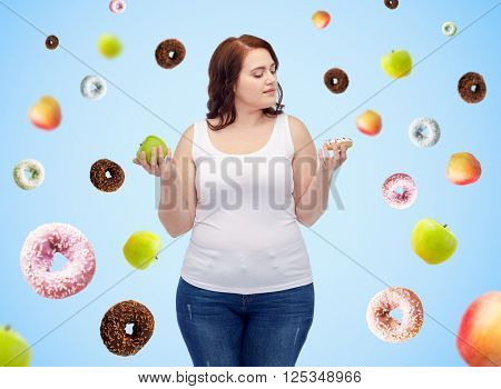 healthy eating, junk food, diet and choice people concept - plus size woman choosing between apple and donut over blue background