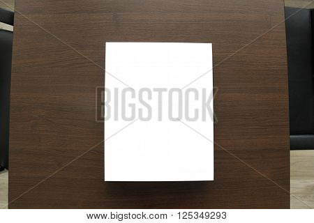 Boardroom table with leather chairs and white template for business proposal or folder