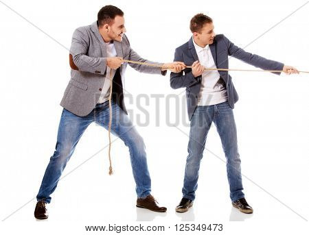 Two businessmen pulling a rope
