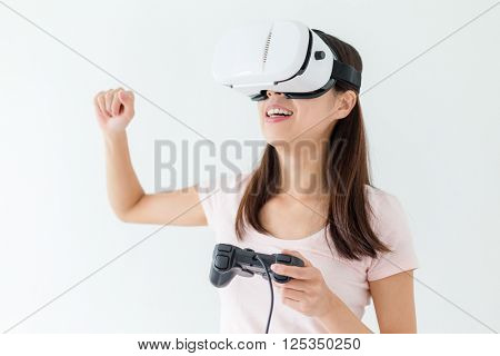 Excited woman play video game with vr device