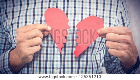 Sad man with broken heart against white background