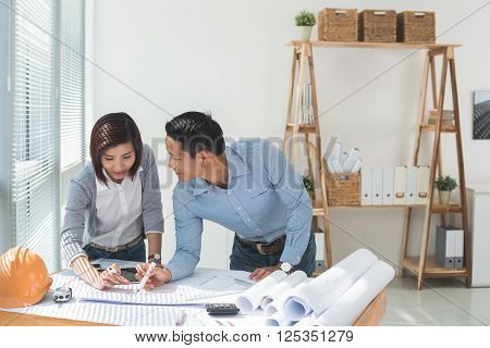 Engineers working on project in architect bureau