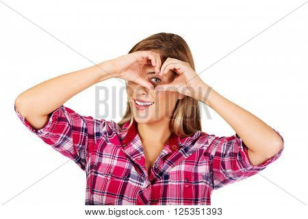 Young woman making a heart hand gesture