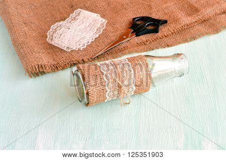 Empty vase, scissors, burlap, lace. Set for handmade vase