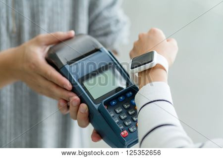 Woman pay with smart watch