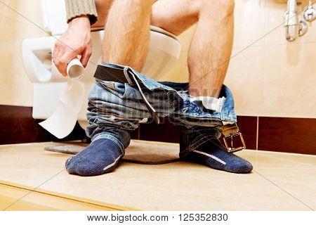 Man sitting on a toilet seat