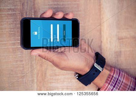 Online banking against man holding smart phone on desk