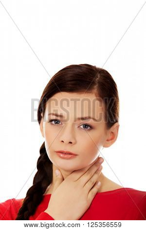 Young woman with throat ache