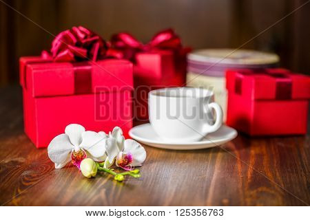 Beautiful Greeting Universal Concept With Red Boxes, Orchid Flower, Phalaenopsis And Cap Of Tea On W