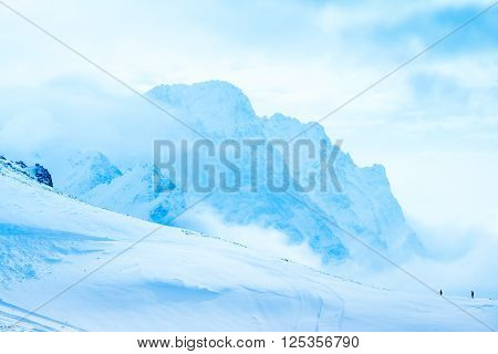 beautiful winter landscape of Dombaj with clouds and descent from the mountain