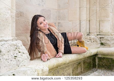 Sexy Female Legs. Fashion Long Legs Brunette Girl On Bench.