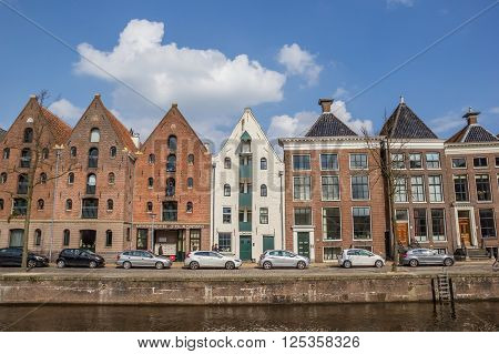 GRONINGEN, NETHERLANDS - APRIL 9, 2016: Warehouses at a canal in Groningen, The Netherlands