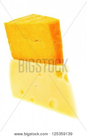 two french gourmet yellow cheeses  isolated over white background